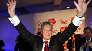 Peter Robinson accepts the applause following his speech at the DUP conference on Saturday