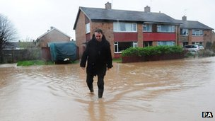 A man walks through flood water near his home in Northallerton, North Yorkshire. 
