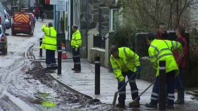 Workmen clearing up after flooding