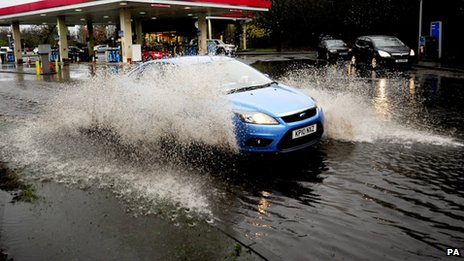A car drives through floodwater on the A1 in North Yorkshire