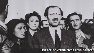 Menachem Begin surrounded by Irgun fighters on the anniversary of the sinking of the Altalena