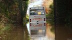 School bus stuck in floodwater in Halwill Junction in Devon. Pic: Peter Hayes