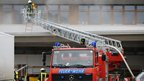 Firefighters at the blaze-hit building in Titisee- Neustadt, southern Germany, on 26/11/12