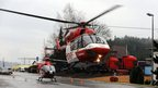 Helicopter lands to evacuate the injured from the fire at Titisee- Neustadt, southern Germany, on 26/11/12