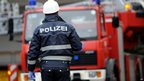 Policeman at the scene of the blaze-hit building in Titisee-Neustadt, southern Germany, on 26/11/12