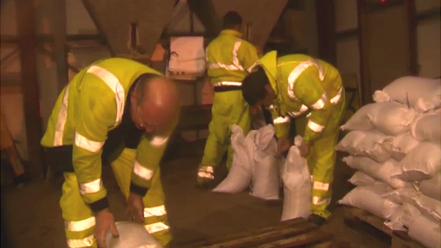 Council workers fill sandbags