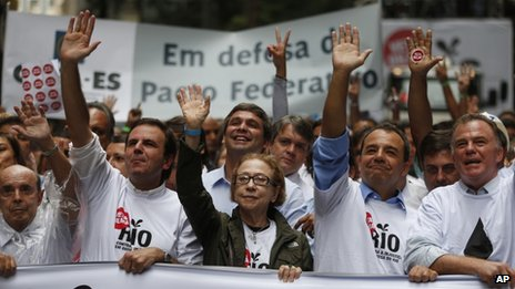 Rio de Janeiro's Governor Sergio Cabral, second from right, Brazilian actress Fernanda Montenegro, centre, and Rio de Janeiro's Mayor Eduardo Paes, second from left, lead a march in Rio de Janeiro