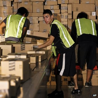 Workers pack a lorry at the Amazon.com plant in Phoenix, Arizona, on 26 November 2012