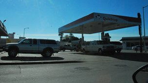 Pick-up trucks at a petrol station in the US