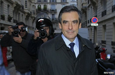 Francois Fillon leaves his apartment in Paris, 27 November