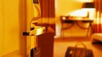 Hotel door and view into room, copyright Thinkstock