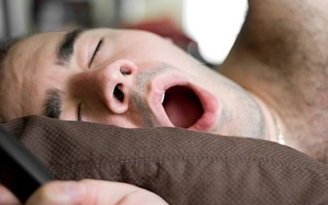 A man yawning