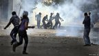 Egyptian security forces arrest a protester during clashes