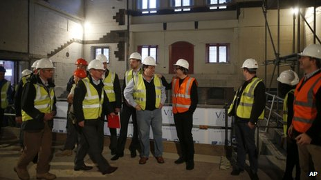 "Members of the team behind the new indoor venue at Shakespeare""s Globe gather to pose for a group photograph for the media during a publicity event in London"