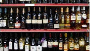 Rows of bottle on supermarket shelf