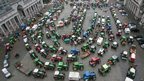 Tractors belonging to dairy farmers are parked on the Cinquantenaire square in Brussels on November 27