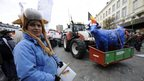Dairy farmers stage a protest against EU agricultural policies at the Place du Luxembourg, near the European Parliament