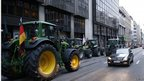 Tractors block the entrance of the European Commission's agriculture office during a protest by European milk producers in central Brussels