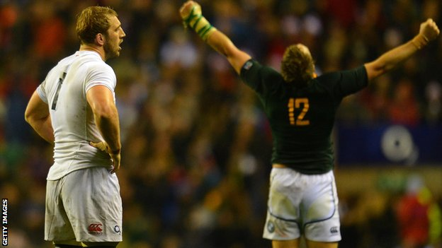 Chris Robshaw looks on as South Africa captain Jean de Villiers celebrates victory on Saturday