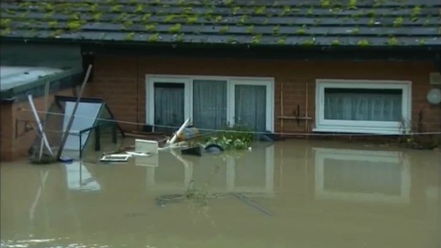 The woman's body was found in her flooded home by rescue workers