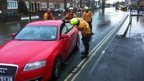 Firefighters tow a vehicle on the flooded Abingdon Road