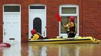 RNLI crew in flooded part of St Asaph, north Wales