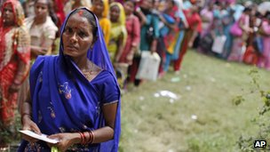 nemployed educated Indian women stand in a queue to register themselves at the Employment Exchange Office in Allahabad, India. 