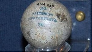 A gutta percha golf ball held at The Royal and Ancient Golf Club