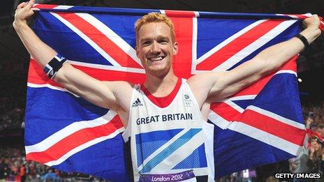 Greg Rutherford celebrates winning gold at London 2012