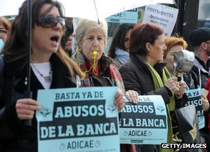 Ordinary savers protest outside a branch of Bankia