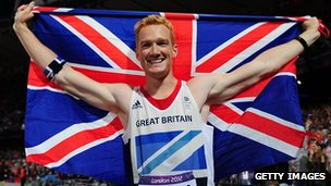 Greg Rutherford celebrates winning gold at London 2012