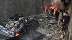 Twin blasts shake Damascus suburb