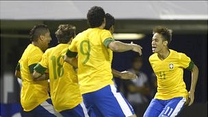 Brazil players celebrate a goal against Argentina