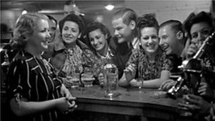 Women and men in pub in 50s