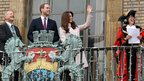 Catherine, Duchess of Cambridge and Prince William, Duke of Cambridge smile and wave to the crowds from the balcony of Cambridge Guildhall