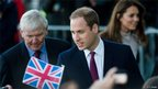 Prince William, Duke of Cambridge speaks with members of the public as he and Catherine, Duchess of Cambridge arrive for a visit to Peterborough City Hospital