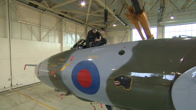 Men working on the last remaining Vulcan aircraft