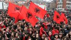 Ethnic Albanians waves Albanian flags during a rally marking the Albanian Flag Day in Presevo, southern Serbia (28 Nov 12)