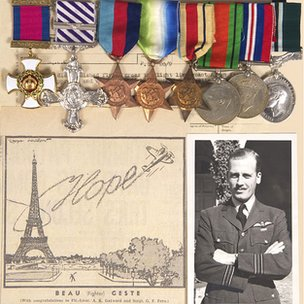 Wing Commander Ken Gatward, his medals and a cartoon depicting his wartime exploit