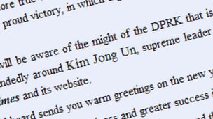 Enlarged Kim Jong Un in text