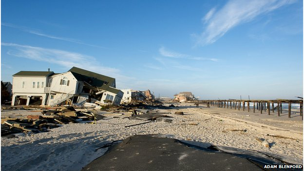 Ruined homes and the Surf Club in the distance on Ocean Avenue