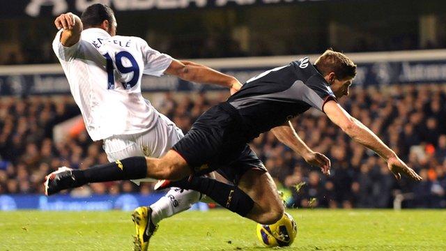 Steven Gerrard goes down under a challenge by Mousa Dembele