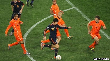 Cesc Fabregas of Spain charges through the Netherlands defence during the 2010 FIFA World Cup South Africa Final 