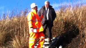 Secretary of State for transport, Patrick McLoughlin, at the scene