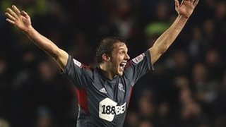 Stephen Warnock celebrates Bolton's equaliser at Brighton