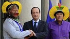 French President Francois Hollande (centre) shakes hands with Brazilian Indian chief Raoni Txukarramae (left), the chief of the Amazonian Indian tribe Kayapo