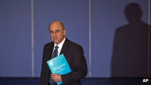 Lord Justice Leveson holds a summary of his report