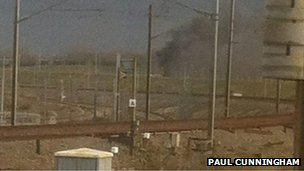 Smoke pours from a freight train  near the French end of the Channel Tunnel (photo: RTE correspondent Paul Cunningham)