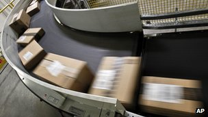 Packages ready to ship move along a conveyor belt at Amazon.com