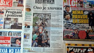 Front pages of Serbia&#039;s leading newspapers displayed on November 17, 2012, with one showing a column of Serb refugees fleeing Krajina in 1995.
